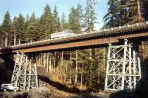Zinc Creek Bridge on Admiralty Island in S.E. Alaska used site-assembled steel towers, on grouted-in-place precast footings, with pre-engineered modular superstructures. 250' long and built in a week